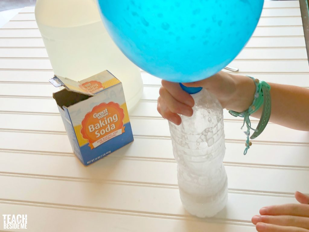 blowing up a balloon with vinegar and baking soda