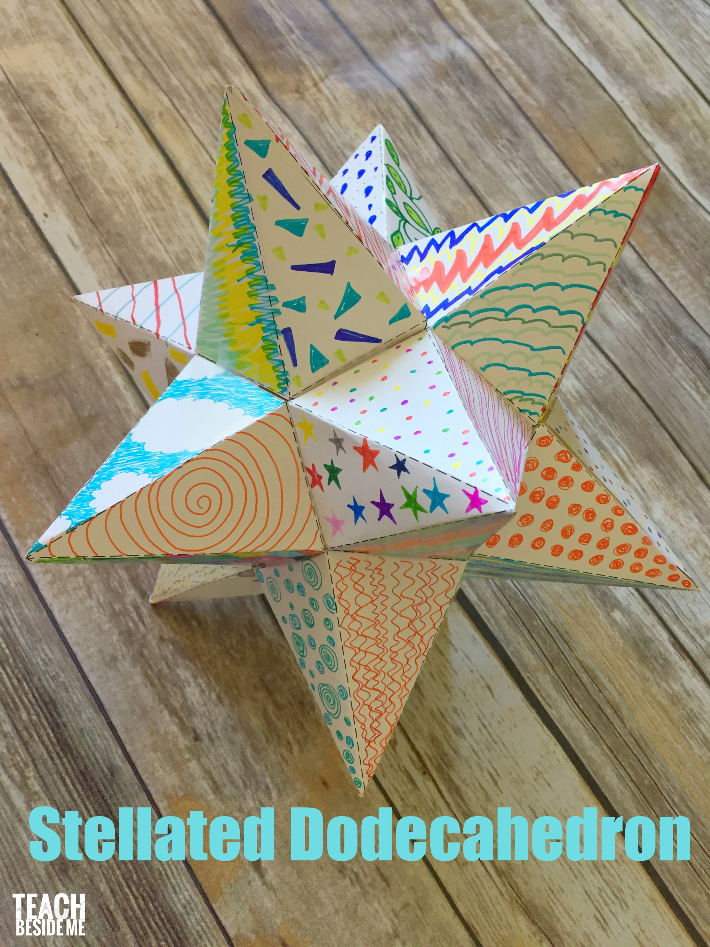 paper stellated dodecahedron with a template teach beside me