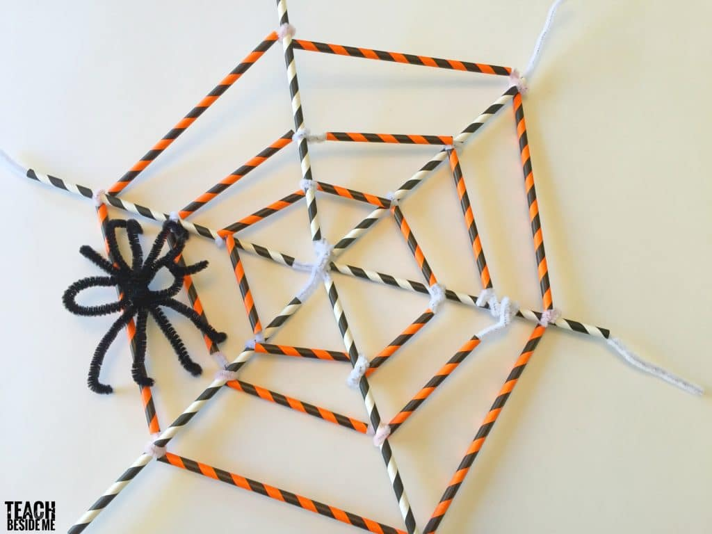 Straw and pipe cleaner spider web with pipe cleaner spider