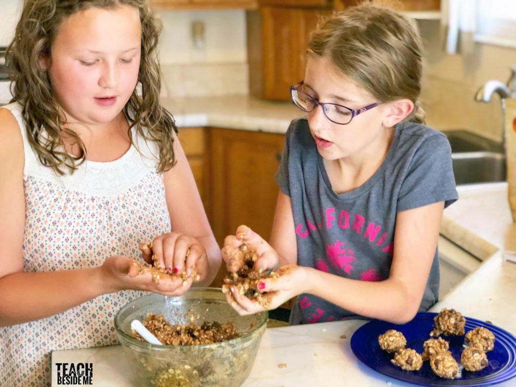 kids in the kitchen-peanut butter balls.