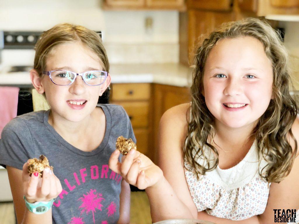 kids in the kitchen making peanut butter balls