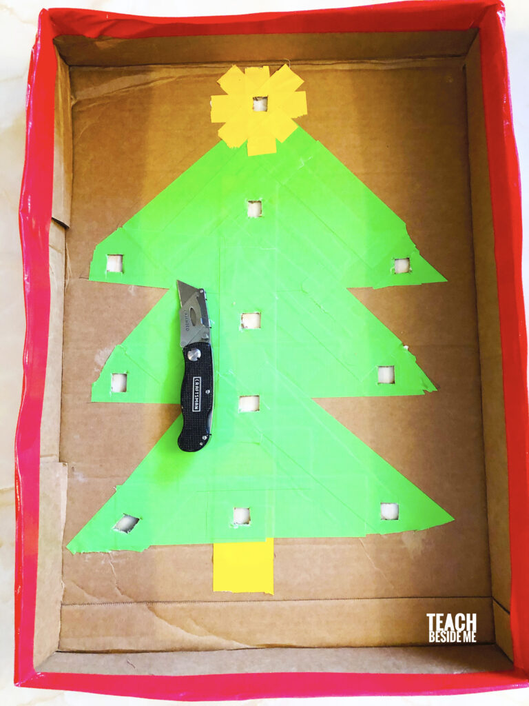 make a homemade christmas game with marbles for kids