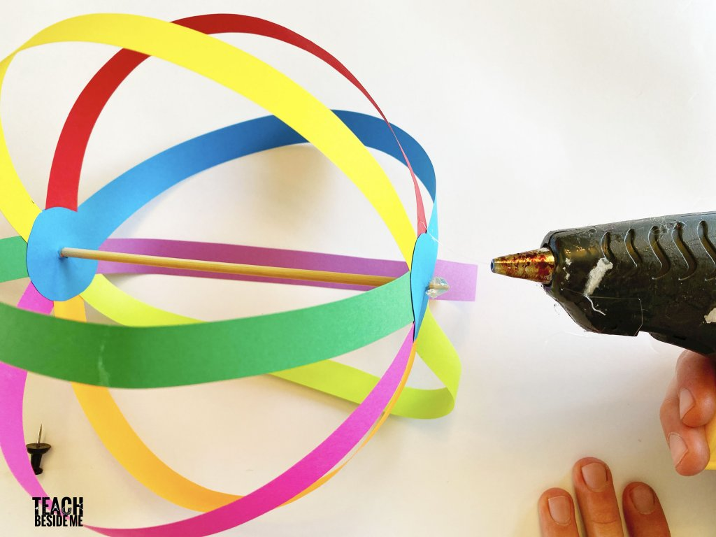 gluing paper spinner toy